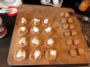 Flatten half the balls on a surface and carefully add half a teaspoon of peanut butter and then fluff!